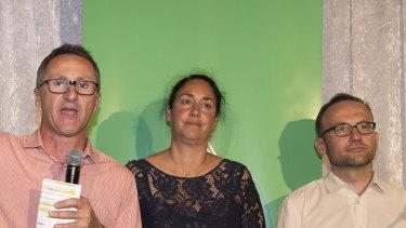 Greens leader Richard Di Natale (left), Greens candidate for Batman Alex Bhathal (centre) and deputy leader Adam Bandt concede defeat in Batman.