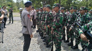 Police and military in Timika, Papua, late last year.