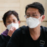 Passengers from Wuhan arrive at Sydney Airport wearing masks.
