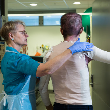 Senior physiotherapist Julie Bricknell with a patient in the Royal North Shore Hospital Burns Unit.