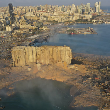 A drone picture shows the scene of an explosion that hit the seaport of Beirut, Lebanon, Wednesday, Aug. 5, 2020