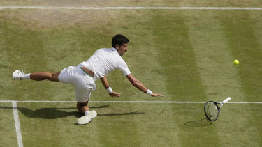 Djokovic falls while attempting to return a ball during the semi-final on Friday.