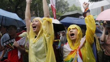 Same-sex marriage supporters cheer outside the Legislative Yuan in Taipei, Taiwan, on Friday.