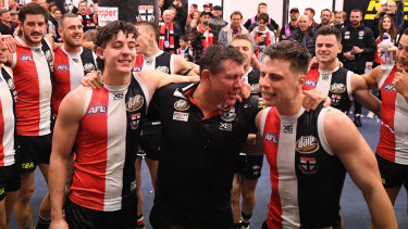 St Kilda caretaker coach Brett Ratten celebrates with his side on Sunday.