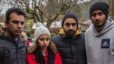 Poshik Sharma's friends and family in Marysville on Sunday.