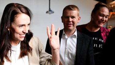 Jacinda Ardern waves to supporters at an Auckland cafe on Sunday morning, after her election victory.