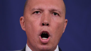 Home Affairs Minister Peter Dutton addresses the media after three Melbourne men were charged with terror offences.