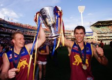 Michael Voss and Simon Black celebrate another of the three premierships wins in the 2000s.