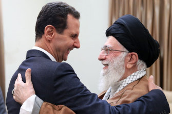 Iran's Ayatollah Ali Khamenei, right, welcomes Syrian President Bashar al-Assad in Tehran, Iran in February.