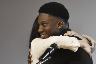 "Meghan embraces head boy Aker Okoye. He later said: ""She really is beautiful, innit."""