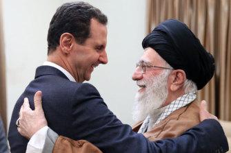 Iran's Ayatollah Ali Khamenei, right, welcomes Syrian President Bashar al-Assad in Tehran, Iran in February.
