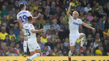 On-song: Leeds United's Pablo Hernandez (top left) celebrates scoring his side's third goal against Norwich.