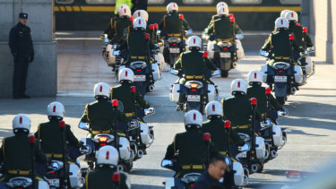 A Chinese motorcade enters Beijings station to escort North Korean leader Kim Jong-un.