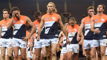 The Giants leave the field after putting up feeble resistance to Hawthorn on Sunday.