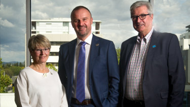 Chief Minister Andrew Barr (centre) at the charity's funding round announcement with the chair of the Hands Across Australia board, Diane Kargas Bray, and chief executive Peter Gordon. Photo: Elesa Kurtz