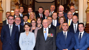 NSW Premier Gladys Berejiklian and her new ministry pose for a photo with NSW Governor David Hurley at Government House in Sydney.