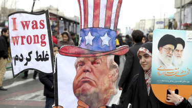 An Iranian woman holds an effigy of US President Donald Trump during a rally earlier this year.