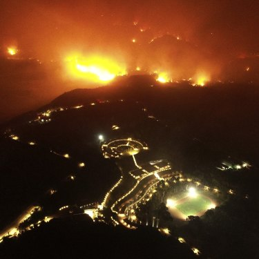 A wildfire approaches the Olympic Academy.