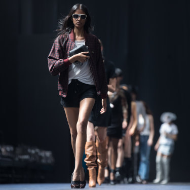 Models practise walking on the runway ahead of the Grand Showcase at VAMFF.