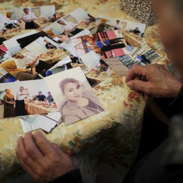 Muhammad Abdullah with a photo of his missing fiancee Nursa Mehmetjan.