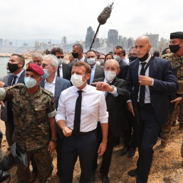 French President Emmanuel Macron inspects the site of the August 4 blast in Beirut.