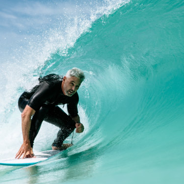 Urbnsurf founder Andrew Ross rides an artificial wave at his facility.
