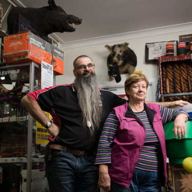 """Everyone feels pretty empty and we feel it in the shop"":  Dave Thwaites and Merilyn Bradley in the newsagent and gun shop in Walgett."