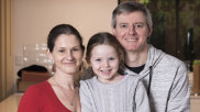 Elspeth and Mal Ennion and their five-year-old daughter Anya at their Randwick apartment.