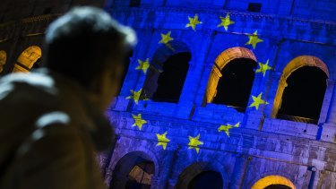 The European Union flag is projected on the Colosseum