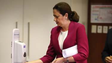 Queensland Premier Annastacia Palaszczuk sanitises her hands at Parliament House.