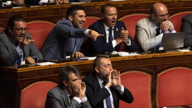 League senators supporting Interior Minister Matteo Salvini shout as Giuseppe Conte address the Senate.