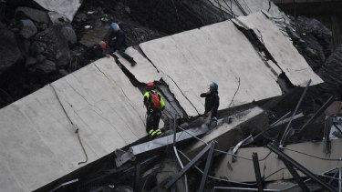 Rescue workers among the debris of the collapsed bridge.