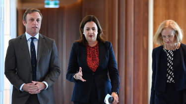 Queensland Health Minister Steven Miles, Premier Annastacia Palaszczuk and Chief Health Officer Dr Jeannette Young leave a press conference after a meeting of the Health and Safety cabinet committee.
