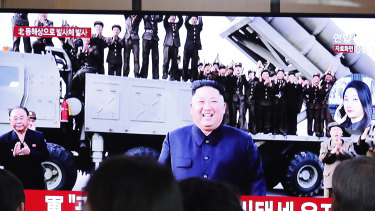 People watch a TV showing a file image of North Korean leader Kim Jong-un during a news program at the Seoul Railway Station in South Korea.
