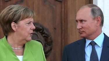 Angela Merkel, Germany's chancellor, left, speaks with Vladimir Putin, Russia's president, during a bilateral meeting at Meseberg castle in Meseburg, Germany.