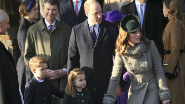 Britain's Prince William and Catherine, the Duchess of Cambridge, stand with their children, Prince George and Princess Charlotte, outside the St Mary Magdalene Church in Sandringham.