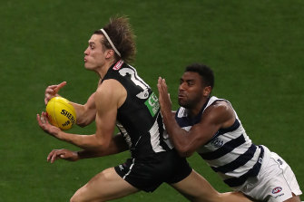Darcy Moore competing against Esava Ratugolea on Thursday night.