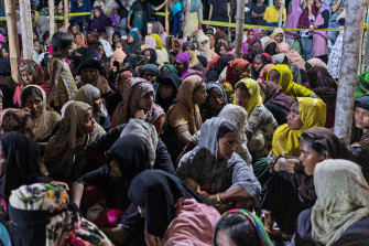Ethnic Rohingya people rest after the boat carrying them landed in Lhokseumawe, Aceh province, Indonesia on Monday.