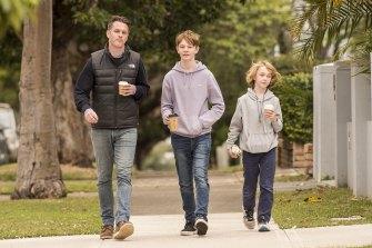 Kogarah MP Chris Minns and sons Joe and Nick on Saturday.