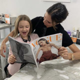 Victoria Beckham and daughter Harper enjoy some quality reading after manicures at a Sydney nail bar.