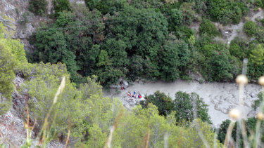 Rescuers work at the Raganello Gorge in Civita, Italy.