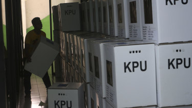 A worker prepares ballot boxes to be distributed to polling stations in Jakarta, Indonesia. The country's Election Supervision Agency says it found evidence postal ballots in Malaysia had been tampered with.