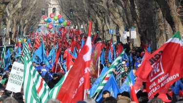 People march during the national trade union demonstration in Rome on Saturday.