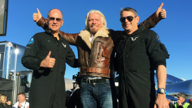 "Richard Branson celebrated with pilots Rick ""CJ"" Sturckow, left, and Mark ""Forger"" Stucky, right, after the successful mission."
