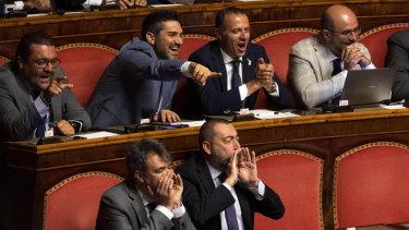 League senators supporting Interior Minister Matteo Salvini shout as Giuseppe Conte address the Senate.