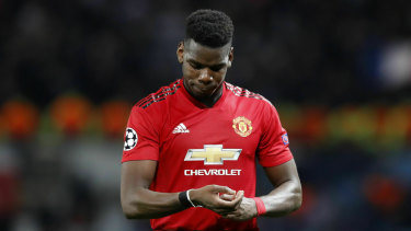 Red card: Manchester United's Paul Pogba leaves the field after being sent off to compound a disappointing night.