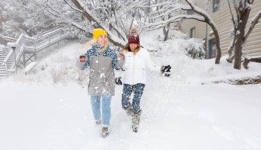 Jasmine Langworthy and Rhylla Morgan revelling in fresh snow at Mt Buller that is opening a week early due to deep snowfalls.