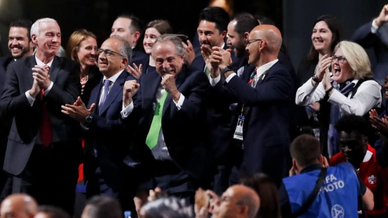 Delegates of Canada, Mexico and the United States celebrate after winning a joint bid to host the 2026 World Cup.