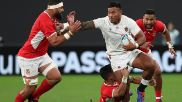 Manu Tuilagi of England makes a break during the Rugby World Cup match against Tonga.