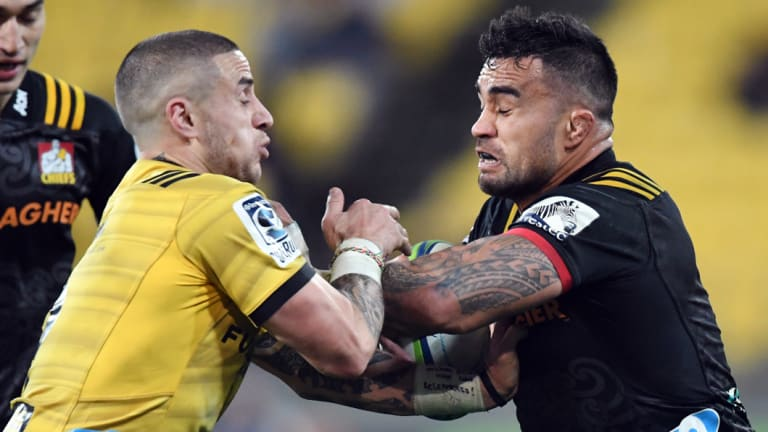 Face off: Liam Messam of the Chiefs grapples with TJ Perenara, who scored twice for the Hurricanes at Westpac Stadium.